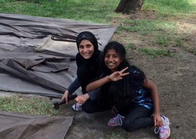 Zuhra-and-Sami-enjoying-working-together-on-setting-up-their-tent